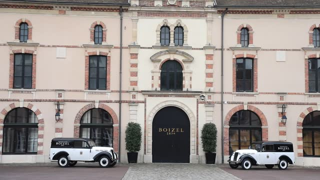 classic cars are parked in front of the entrance of the champagne boizel house on may 15, 2021 in epernay, france. located about 150 kilometers east... - reportage stock videos & royalty-free footage