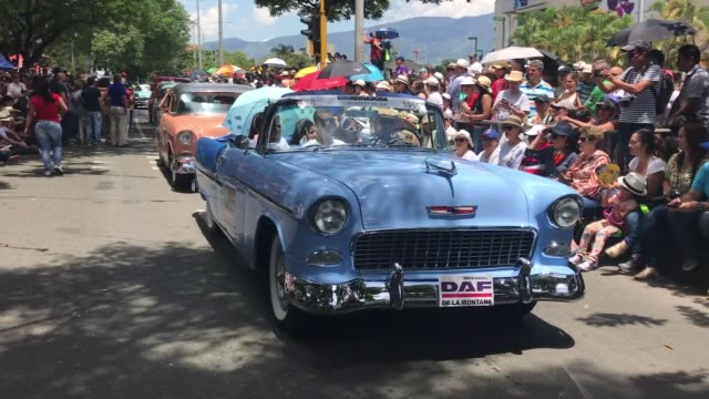 classic cars drive along a street during the classic car parade as part of the flower festival in medellin colombia on august 06 2017 - medellin colombia stock videos & royalty-free footage