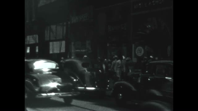 classic cars pass by in downtown philly in the late 1930's - 1930 1939 stock videos & royalty-free footage