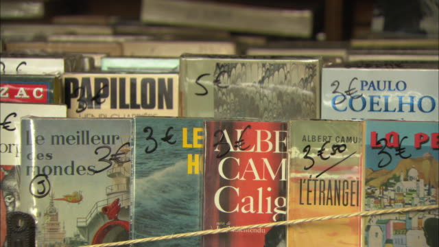 cu pan classic french books on bookstall / paris, france - french culture stock videos and b-roll footage