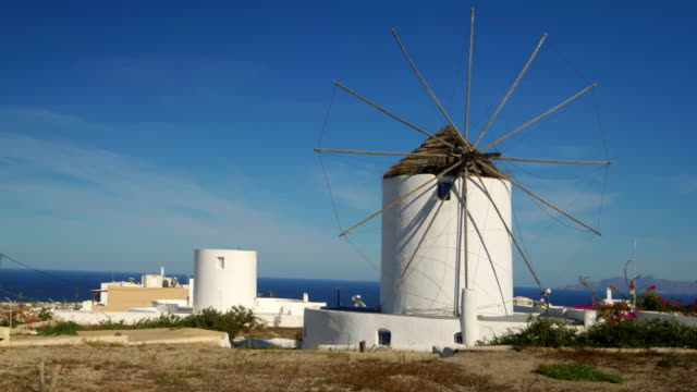classic greek windmill on the mediterranean island of santorini, greece - oia santorini stock videos & royalty-free footage