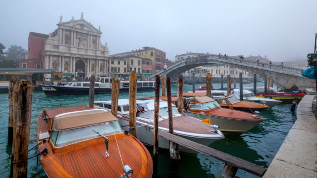 classic italy taxi boat docked infront of venice train station, italy - cultura italiana video stock e b–roll