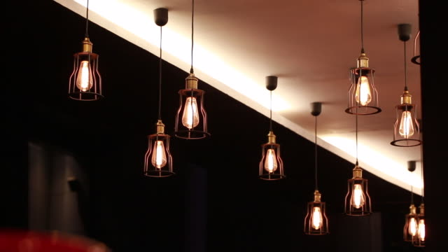 classic lamp at the ceiling in modern restaurant - light bulb stock videos & royalty-free footage