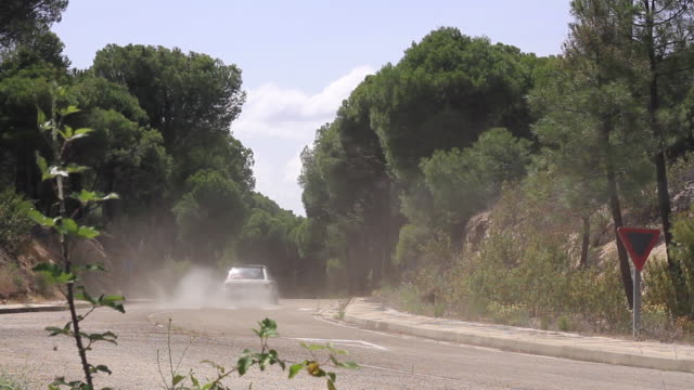 classic renault 5 running a rally in an abandoned road in spring - silvestre stock videos & royalty-free footage