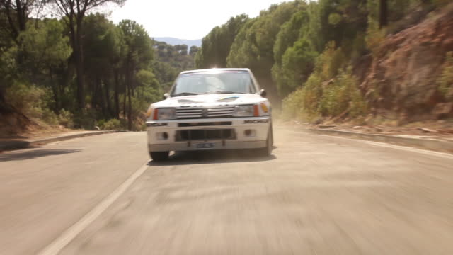 classic renault 5 running a rally in an abandoned road in spring - silvestre stock-videos und b-roll-filmmaterial