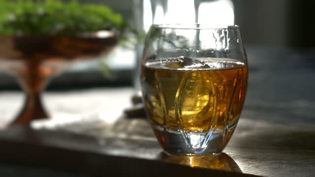 classic scotch whiskey over rocks being stirred - scotch whiskey stock videos & royalty-free footage