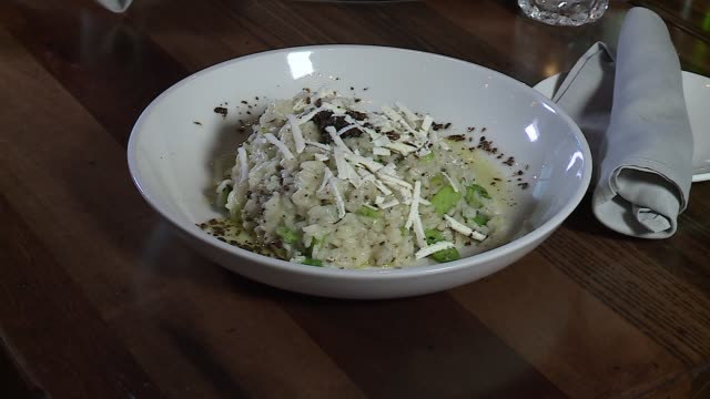 wgn classic seafood risotto in a white bowl at the chicagoarea italian restaurant osteria trulli on april 27 2016 - risotto stock videos & royalty-free footage