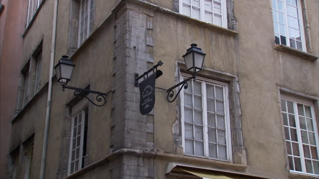 classic signposts hang from a building corner. - corner stock videos & royalty-free footage