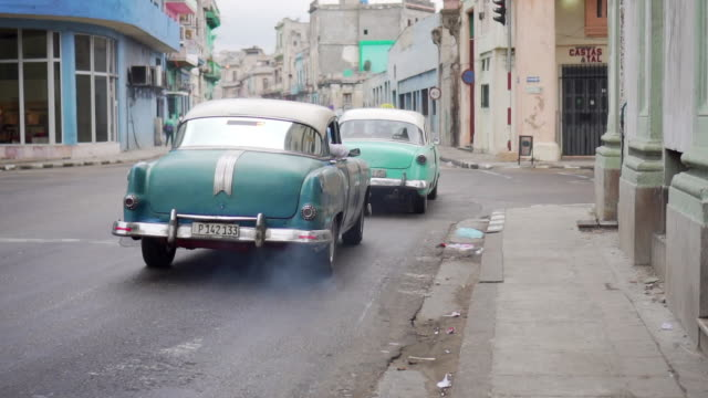 classic vintage cars on streets of havana, cuba - moving past stock videos & royalty-free footage