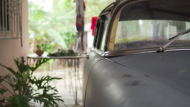 classic vintage cuban car parked in cuban garage - collector's car stock videos and b-roll footage