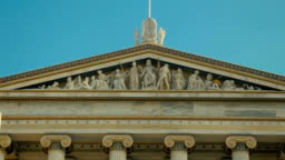 Classical Greek architecture as a symbol of Greece in slow motion.