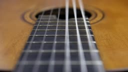 Classical Guitar Strings Vibrating when Song is Played Slow Motion