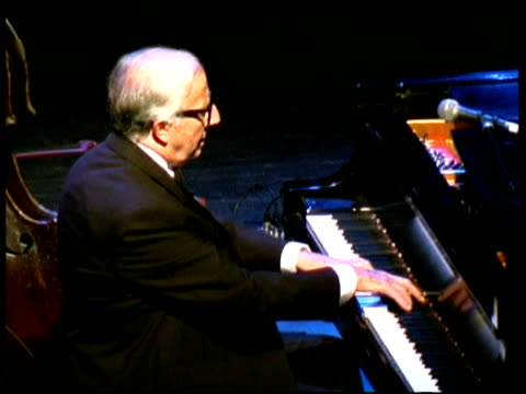 stockvideo's en b-roll-footage met classical jazz pianist, sir george shearing, performing. blind musician, was a major player in british and us jazz. born in britain, moved to us at age 32. - george shearing