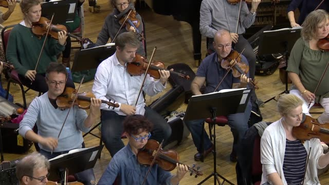 sir simon rattle interview / london symphony orchestra rehearsing england london int **music heard sot** london symphony orchestra musicians... - london symphony orchestra stock videos & royalty-free footage
