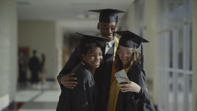 classmate photo bombing friends graduating from high school / springville, utah, united states - springville utah stock videos & royalty-free footage
