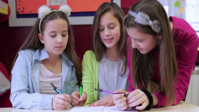 classmates working together - note pad stock videos & royalty-free footage
