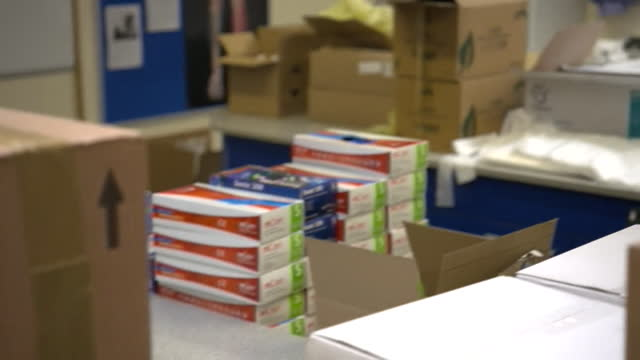 classroom filled with boxes of covid-19 tests, ahead of schoolchildren returning to schools - primary school child stock videos & royalty-free footage