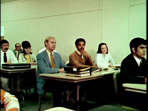 1970 ms pan classroom of full of adults learning to be real estate appraisers, los angeles, california, usa, audio - training course stock videos & royalty-free footage