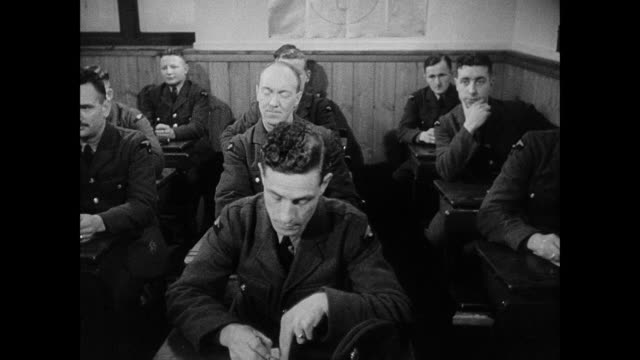 pan classroom of raf airmen sitting at desks and taking notes / united kingdom - allied forces stock videos & royalty-free footage