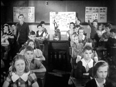1935 b/w montage ws cu classroom of students about age 12 raising their hands, cu boy and girl asking about seeds / usa / audio - asking stock videos & royalty-free footage