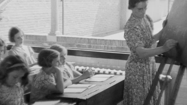 1940 montage classrooms at a school / united kingdom - 1940 stock videos & royalty-free footage