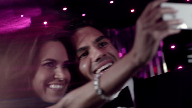 classy couple take selfies with smartphone in limousine at awards show - anniversary stock videos & royalty-free footage