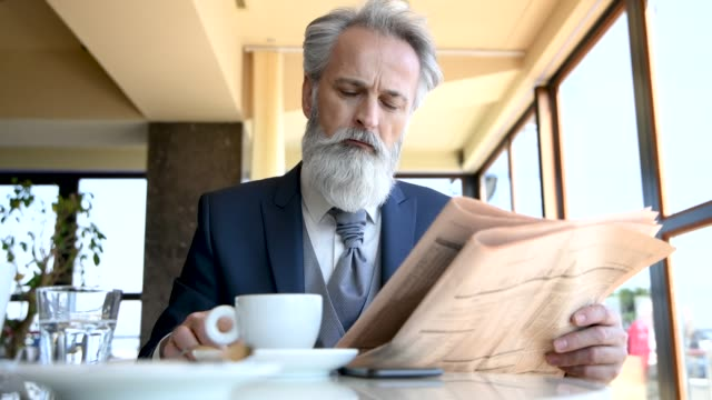 classy dressed senior businessman having good time in coffeehouse - beard stock videos & royalty-free footage