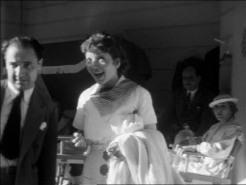 claudette colbert talking with man at outdoor party at pickfair / home movie - 1937 stock videos and b-roll footage