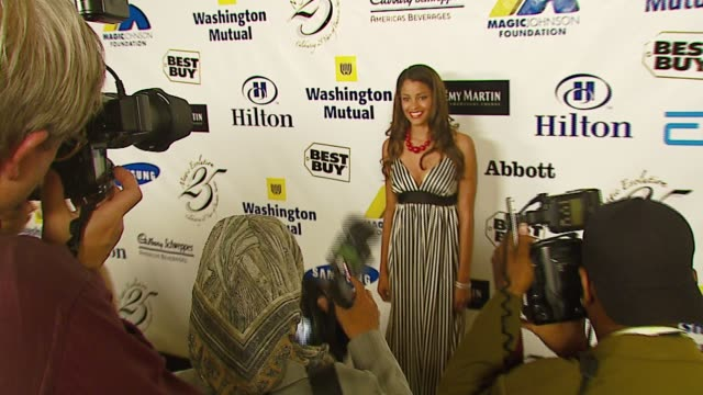 claudia jordan at the celebrities honor magic johnson for 'magic evolution' at the beverly hilton in beverly hills california on september 29 2006 - magic johnson stock videos and b-roll footage