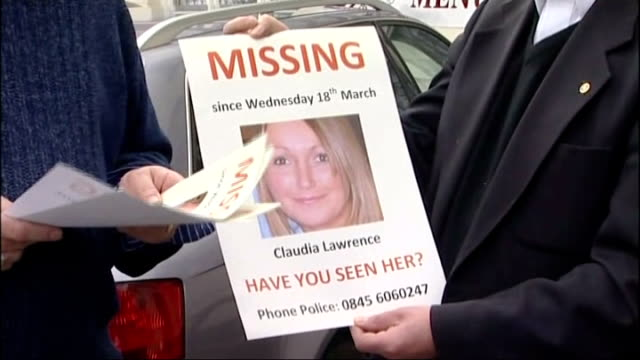 police reenter her house to look for clues setup shot of peter lawrence with 'missing' poster peter lawrence interview sot old adage that time is a... - missing poster stock videos & royalty-free footage