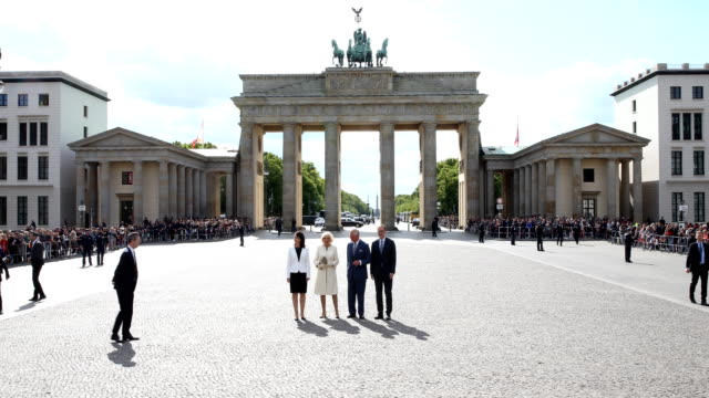claudia mueller and camilla duchess of cornwall are walking after greeting members of the public at the brandenburg gate with prince charles prince... - prinz königliche persönlichkeit stock-videos und b-roll-filmmaterial