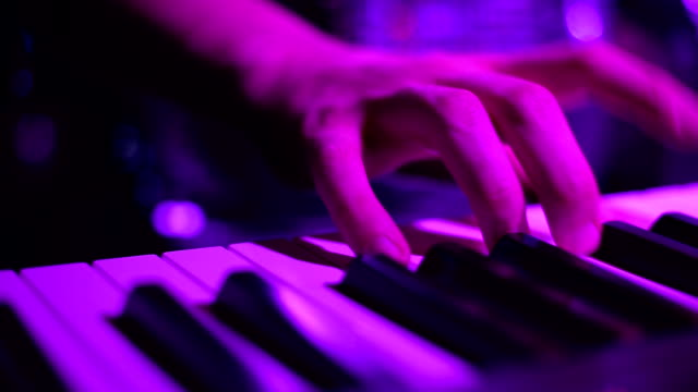 Clavier player. Close up