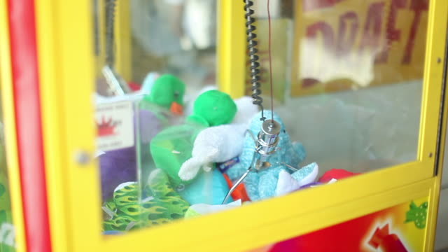 claw game at an arcade with stuffed animals - claw stock videos and b-roll footage