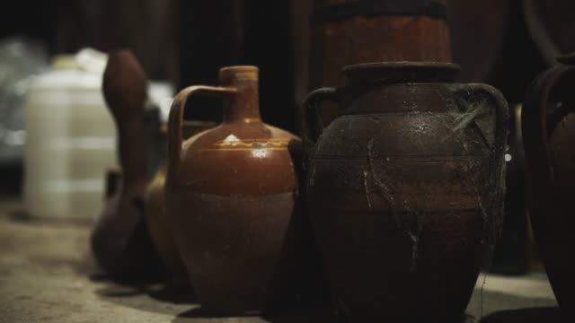 clay and earthenware dish, classic bowls, old crafts, dusty water jugs made of clay, placed  next to one by one - vase stock videos & royalty-free footage