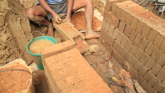 clay brick maker - mud stock videos & royalty-free footage