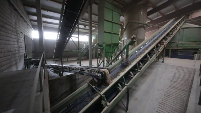 Clay is transported to a storage area for raw material along a conveyor belt at the Wienerberger AG brickmaking plant in Haiding Austria on Monday...
