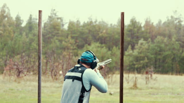 clay target shooter hitting the mark - skeet shooting stock videos & royalty-free footage