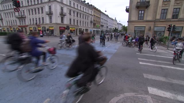 street scenes and general views denmark copenhagen ext various of large number of cyclists along street along with cars and buses / counter on the... - oresund region stock videos and b-roll footage