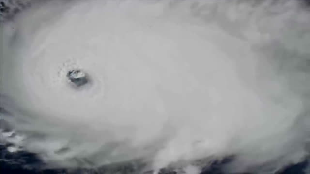 clean and color improved view of the hurricane dorian after hitting the category 5 in the scale saffir simpson hurricane wind scale. the eye of the... - editorial stock videos & royalty-free footage