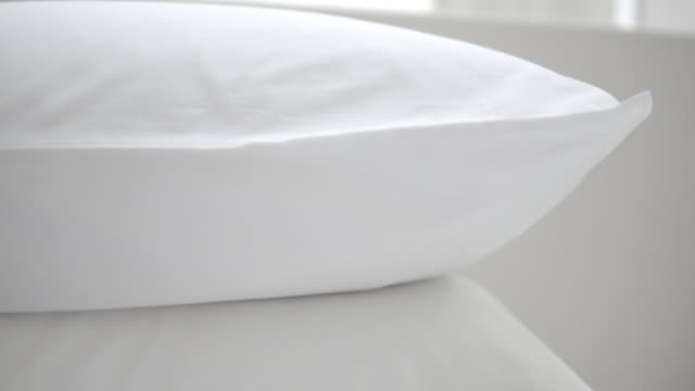 clean and comfort white pillow on bed - bedclothes stock videos & royalty-free footage