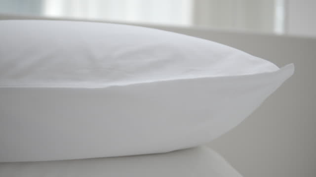 clean and comfort white pillow on bed - pillow stock videos & royalty-free footage