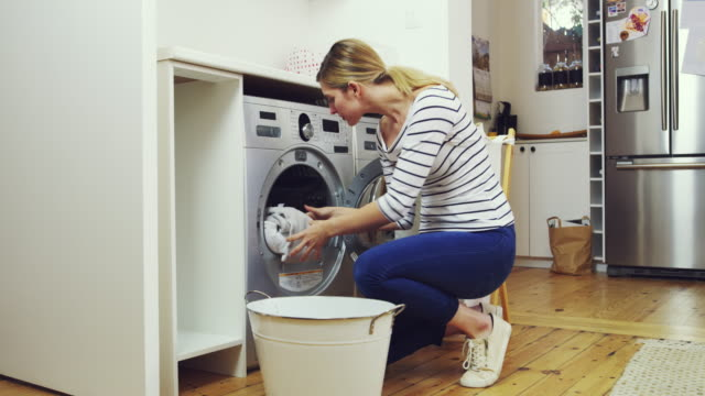 clean and dry. the way every perfect load should be - laundry stock videos & royalty-free footage