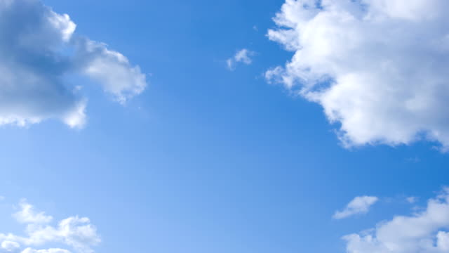 clean blue sky  clouds timelapse - moving past stock videos & royalty-free footage