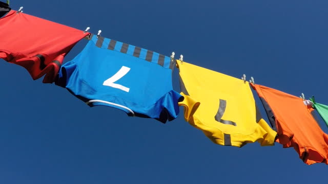 clean colourful sports shirts drying on a washing line. - number stock videos & royalty-free footage