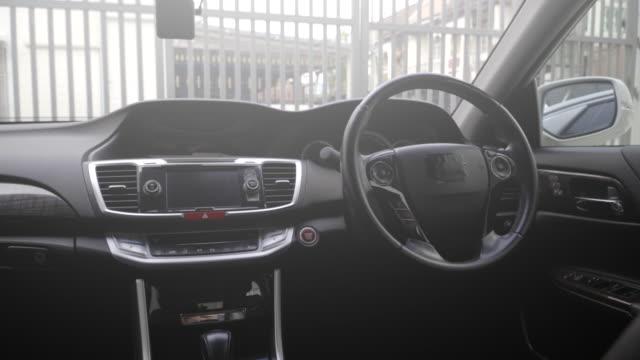 clean console modern car, black indoor design. - car interior stock videos & royalty-free footage
