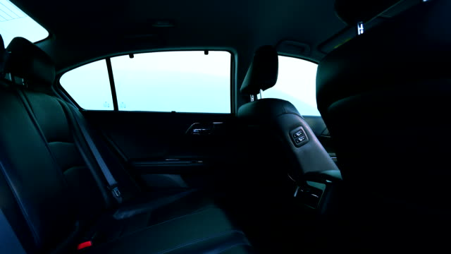 Clean console modern car, indoor design by black leather, dolly camera.