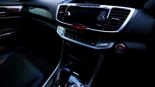 clean console modern car, indoor design by black leather, dolly camera. - new stock videos & royalty-free footage