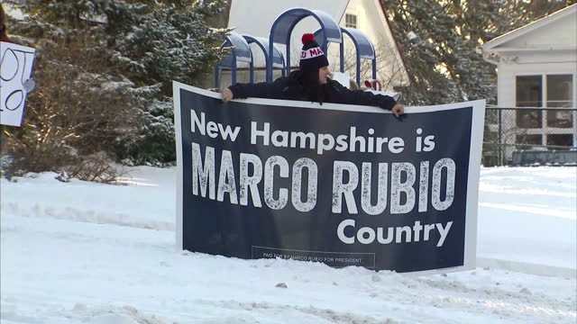 vídeos de stock, filmes e b-roll de clean exterior shots supporters of republican presidential hopeful marco rubio arriving at polling station with placards and posters and shouting... - eleição primária