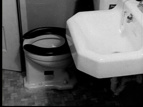 1935 film montage ms clean new toilet and sink/ ms dirty old toilet in outhouse/ jacksonville, florida - toilet stock videos and b-roll footage