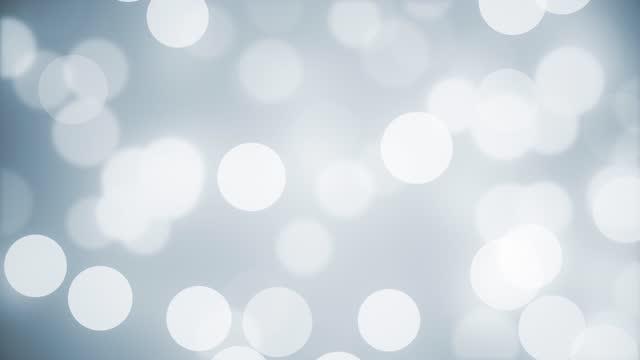 saubere, weiche und glänzende weiße hintergrundanimation. abstrakte verschwommen schöne bokeh bewegung design. die konzepte von berühmtheit, glückliches neues jahr, veranstaltungen, valentinstag, finanzen, spiel, internet, bildung, brainstorming, mode - weiß stock-videos und b-roll-filmmaterial
